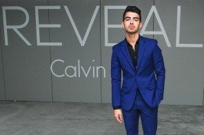 Joe Jonas was on hand last night to help Calvin Klein celebrate the launch of its new fragrance 'Reveal'. For the New York event, Jonas was outfitted by Calvin Klein Collection, wearing a rich tailored blue suit.