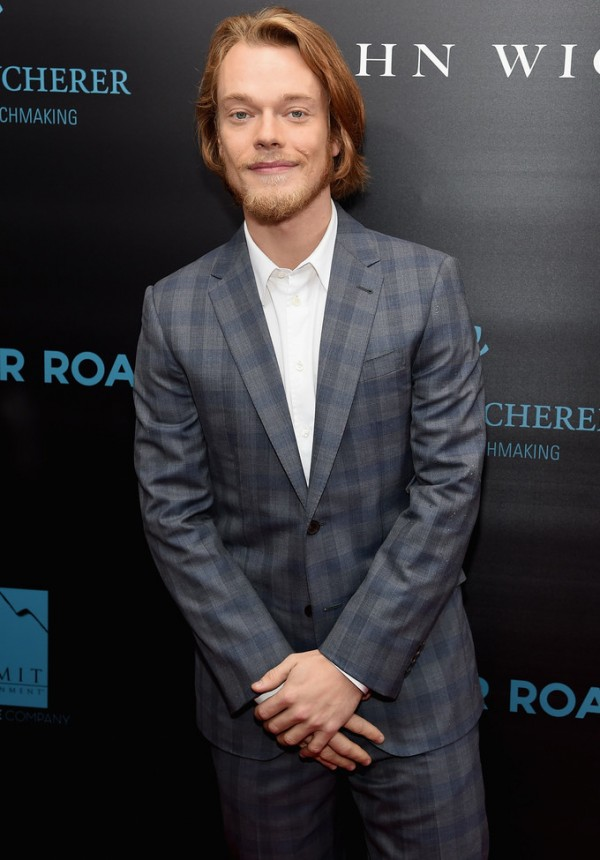 Attending the New York premiere of 'John Wick' on October 13, 2014, 'Game of Thrones' actor Alfie Allen hit the red carpet in a tailored two-button windowpane suit from French fashion label Louis Vuitton. Keeping it semi-casual, Allen opted for a clean, crisp white dress shirt sans tie.