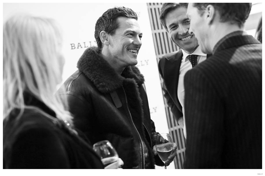 Trying on a Bally shearling jacket, Luke Evans is all smiles while chatting with Showing off his Bally Made-to-Color shoes, Bally CEO Frédéric de Narp and actor Benedict Cumberbatch.