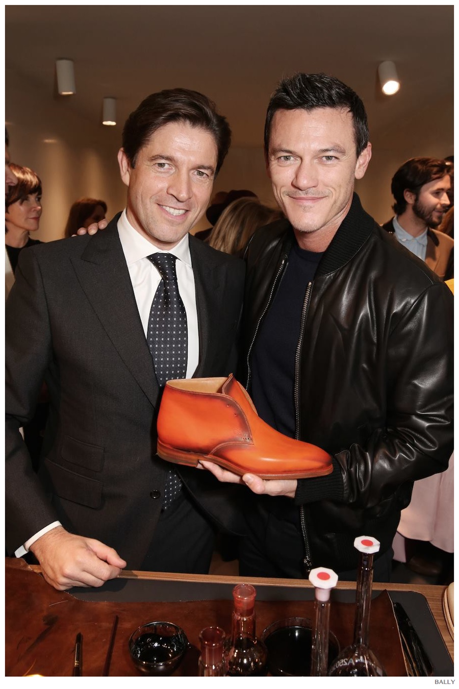 Showing off his Bally Made-to-Color shoes, Luke Evans poses with Bally CEO Frédéric de Narp.