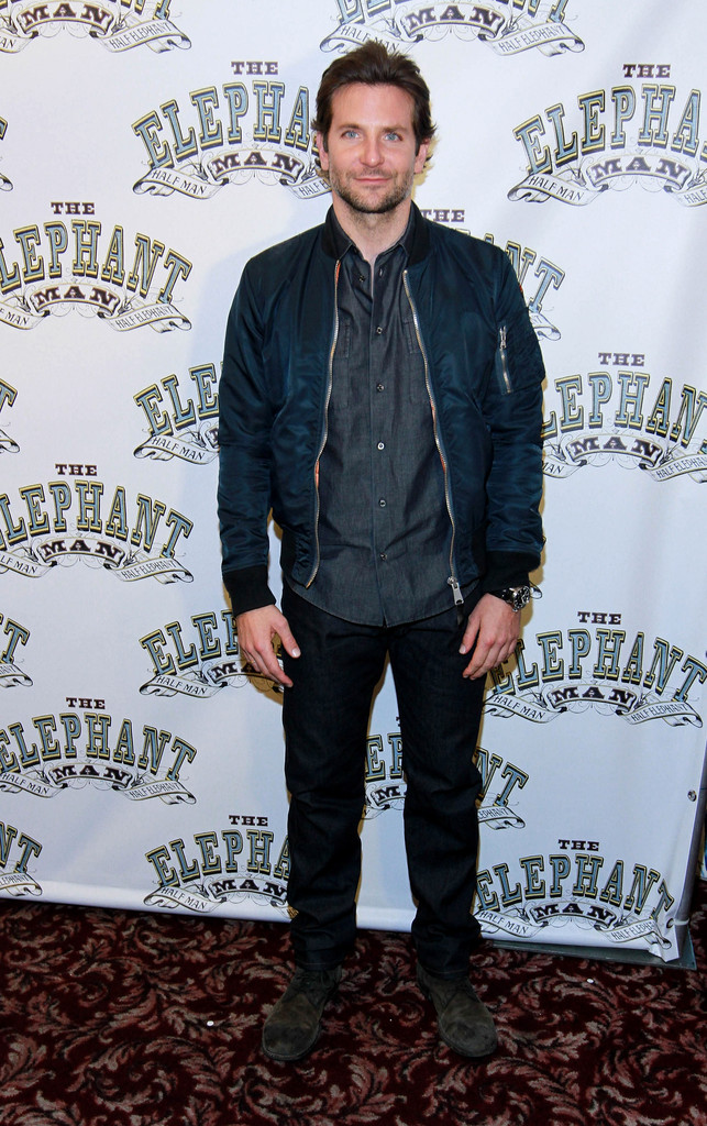 Wearing his favorite Dolce & Gabbana bomber jacket, actor Bradley Cooper kept his ensemble simple with a denim shirt and pair of jeans for 'The Elephant Man' photocall at Sardi's on October 21st.