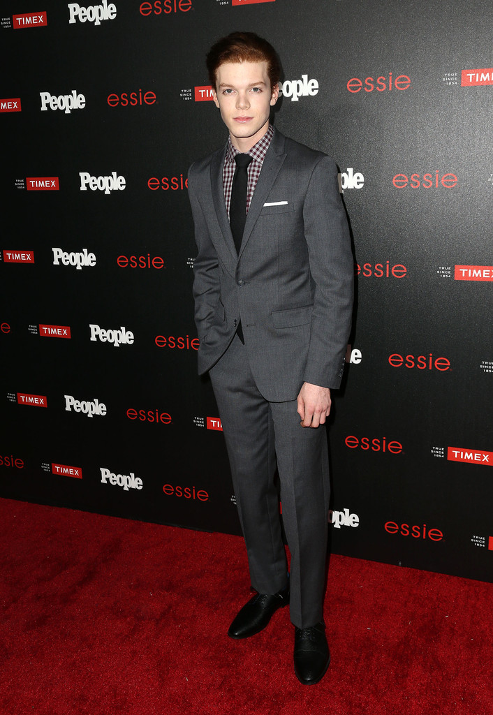 Attending People's 'Ones to Watch' event in Los Angeles on October 9, 2014, 'Shameless' actor Cameron Monaghan wore a tailored charcoal suit with a plaid dress shirt.