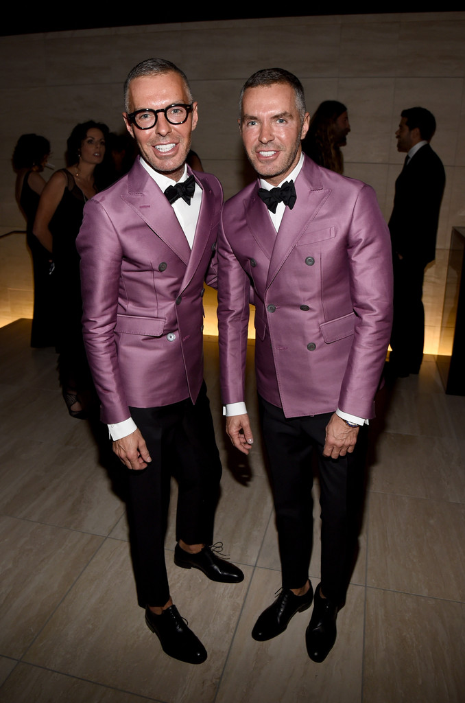 Dsquared2 designers Dan and Dean Caten make a splashy statement in matching purple double-breasted jackets.