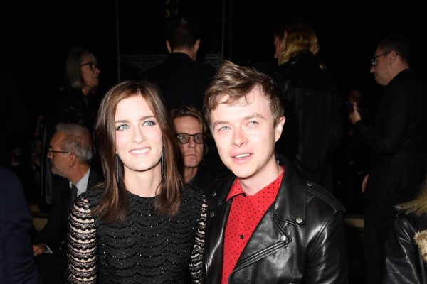 Actor Dane DeHaan and his wife Anna Wood were front row at Hedi Slimane's spring 2015 womenswear show for Saint Laurent on September 29th during Paris Fashion Week. For the show, DeHaan wore a black and red look from the label, sporting one of the label's essential leather biker jackets.