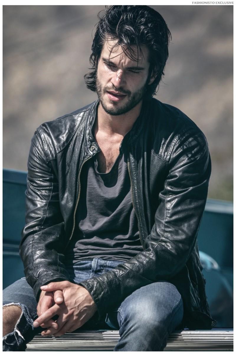 Daniel wears leather jacket Armani Jeans, shirt and jeans AllSaints.