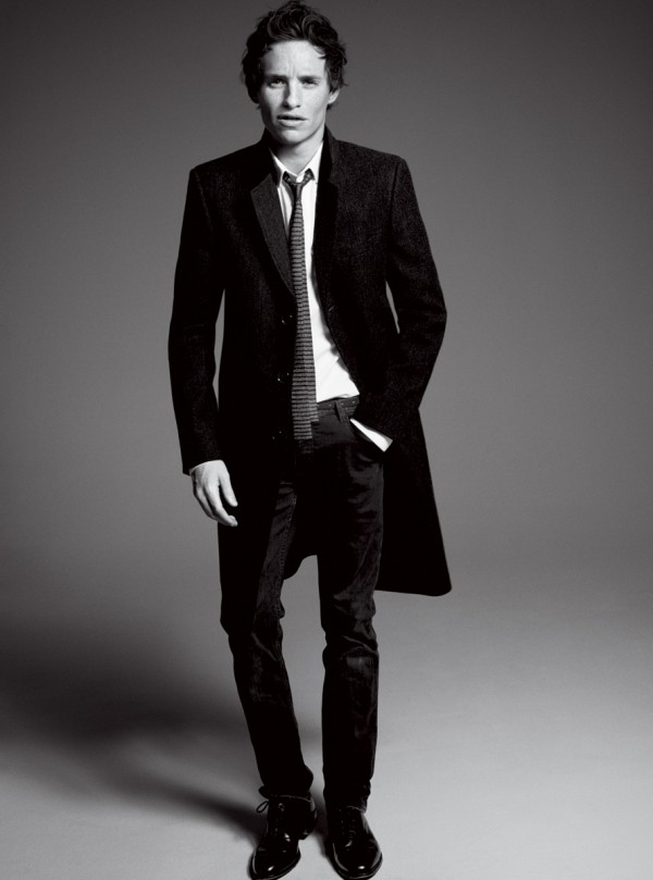 Eddie Redmayne wears coat and tie Saint Laurent by Hedi Slimane, shirt Dior Homme, jeans Burberry Brit and shoes Church's. Photo by David Sims.