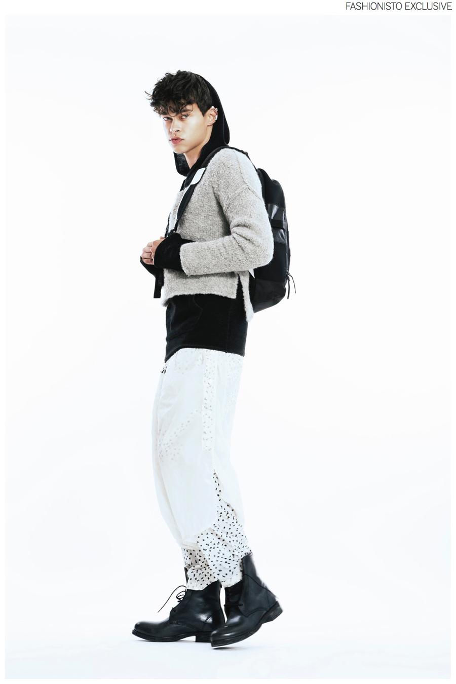 Tobias wears black hoodie Gabba, knit sweater Fall Winter Spring Summer, pants Henrik Vibskov, boots Diesel, backpack Y-3 and earrings Bjorg.