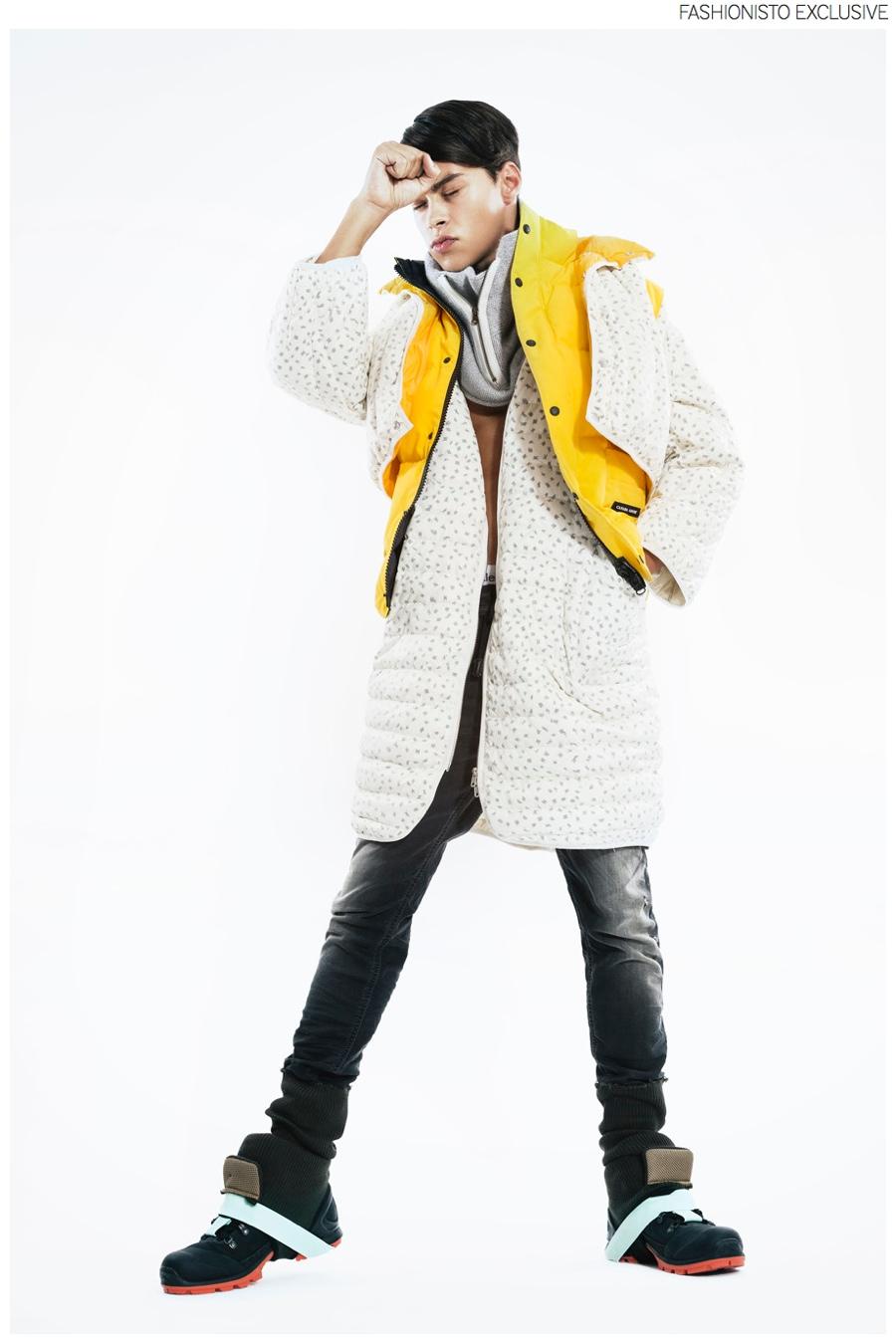 Tobias wears jacket Henrik Vibskov, yellow vest Canada Goose, denim sweatpants Diesel, gray neckpiece Johnnylove and boots Herik Vibskov.