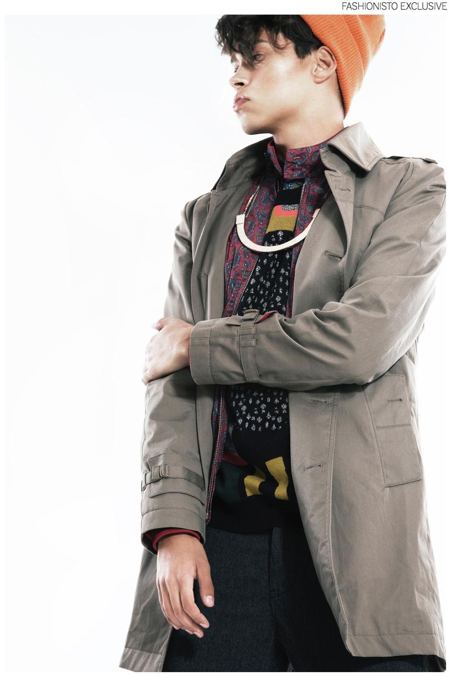 Tobias wears floral shirt NN.08, sweater Henrik Vibskov, red and blue jacket Ben Sherman, gray pants NN.08, trench Johnylove, necklace Bjorg and beanie Samsoe Samsoe.