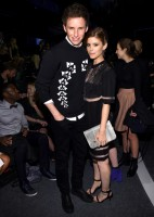 Actor Eddie Redmayne poses with actress Kate Mara. Redmayne wears a pullover from the Alexander Wang for H&M collection.