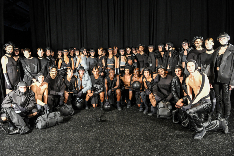 The models pose for a group photo backstage.