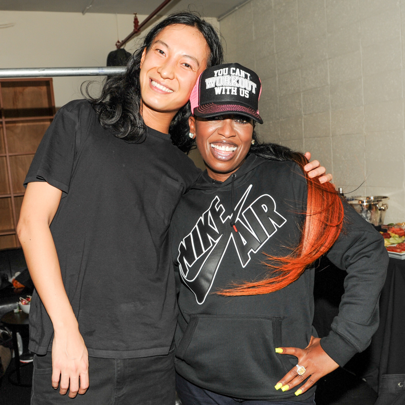 Designer Alexander Wang poses for a photo backstage with Missy Elliott, who performed for the event.