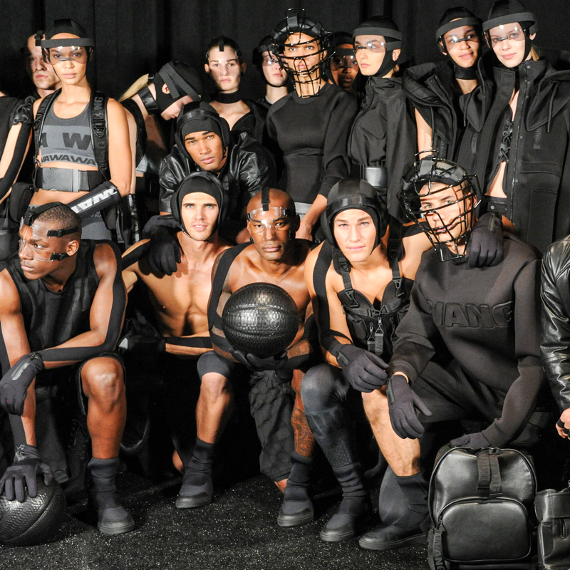 Models including Brian Shimansky, Tyson Beckford and Tyler Maher pose for a group photo backstage.