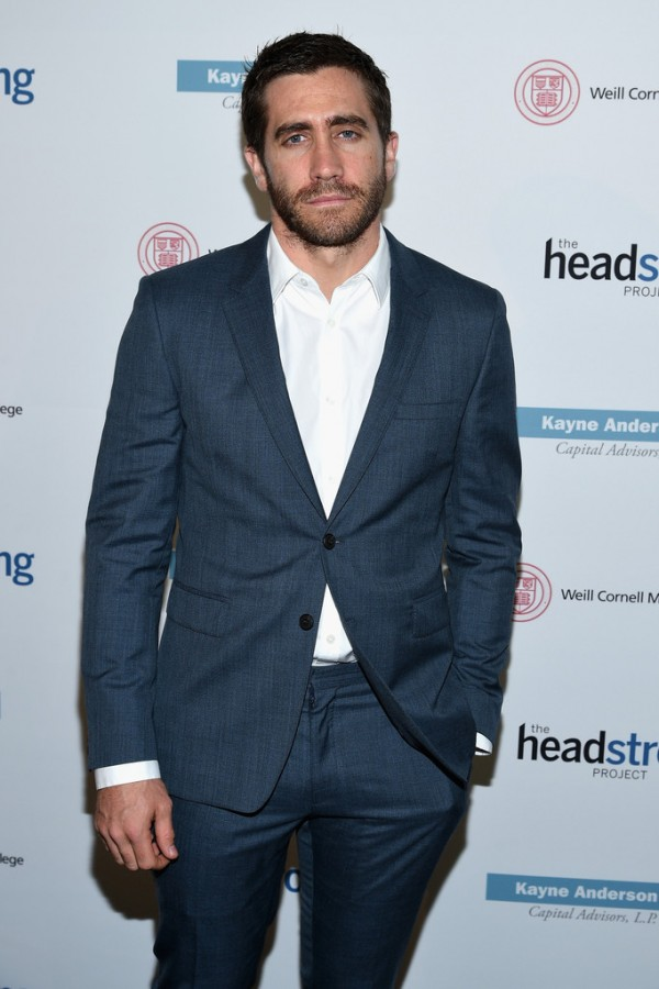 Attending The Headstrong Project 'Words of War' benefit on October 1, 2014 in New York City at the Tribeca 360, actor Jake Gyllenhaal dressed to impress in a tailored charcoal two-button suit sans tie.