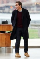 Actor Jake Gyllenhaal keeps his style classic on the set of his upcoming movie 'Demolition'. Gyllenhaal completes an overcoat, trousers, crewneck sweater and t-shirt look with brown workboots.