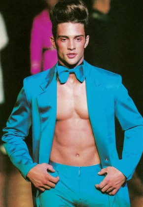 Spring 1996: Gaultier model muse turned actor David Fumero hits the catwalk in a colorful suit.