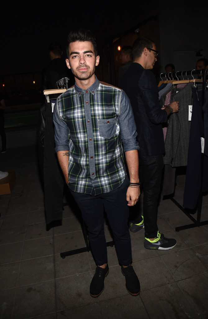 On September 29, 2014, Joe Jonas attended GQ and Gap's celebration of the best new menswear designers in America. For the special occasion at the Ace Hotel, Jonas paired a cord, plaid and denim hybrid shirt with a simple pair of slim-fit pants.