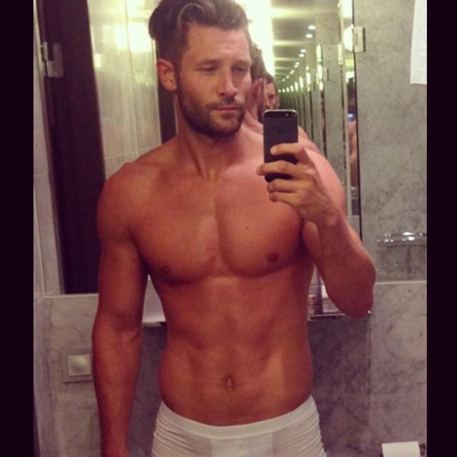 John Halls posts a shameless bathroom selfie.