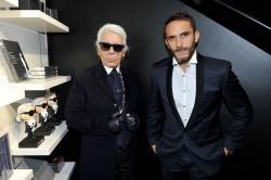 Karl Lagerfeld poses for a photo with Sebastien Jondeau