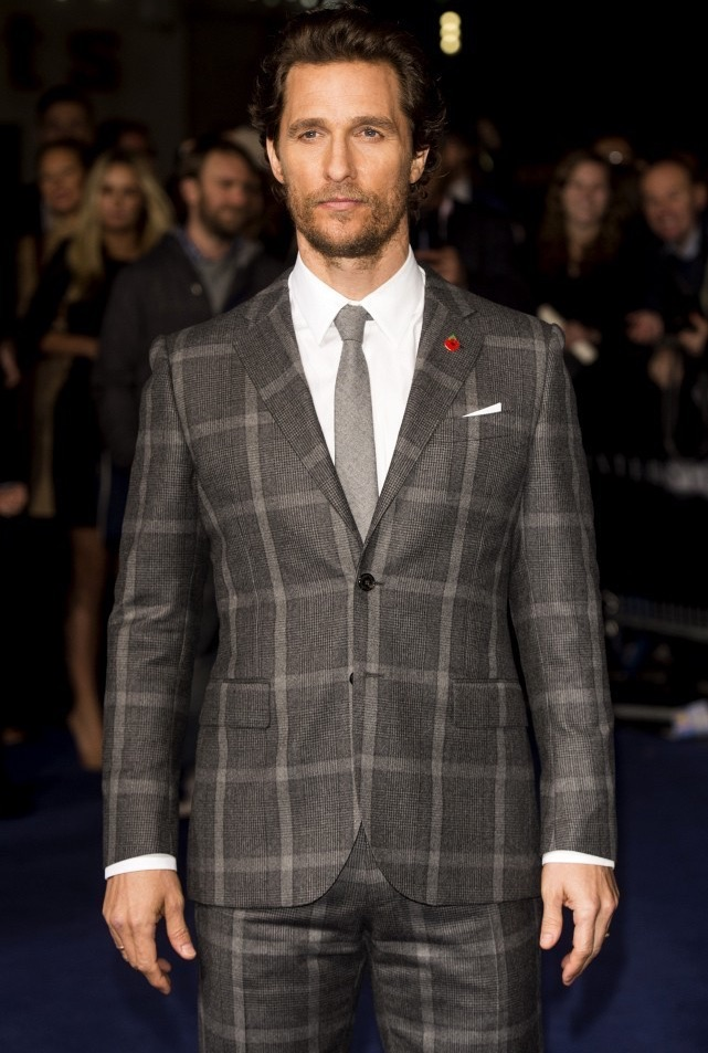 Touching down in London on October 29th for the premiere of 'Interstellar', Matthew McConaughey took a break from Dolce & Gabbana, departing from the usual and sporting a Prince of Wales check suit from Kent & Curwen. McConaughey completed his look with a pair of leather dress shoes from Tod's.
