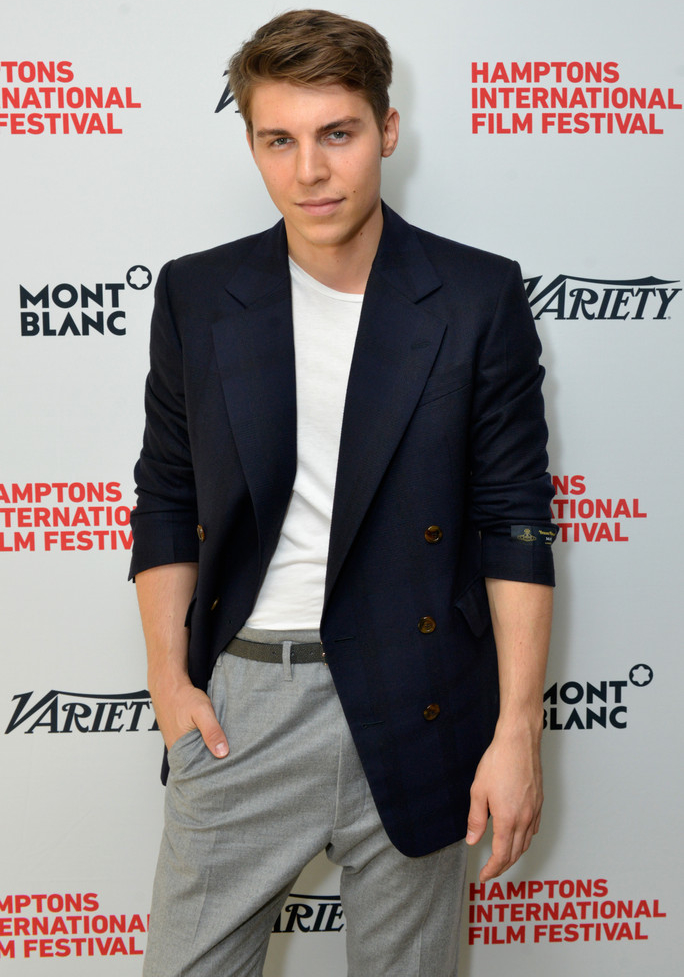 Attending Variety's '10 Actors to Watch Brunch' with Hilary Swank on October 12, 2014, actor Nolan Gerard Funk played it cool and chic in a Vivienne Westwood navy double-breasted jacket with gray 'James Bond' trousers.