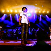 On October 24th, Pharrell took the stage at 'We Can Survive 2014' at the Hollywood Bowl. For his performance, Pharrell wore an electric blue bowler with denim jeans and a graphic white t-shirt that read Chanel Hearts Pharrell. Not surprising, since Pharrell will appear in Karl Lagerfeld's upcoming film for Chanel.