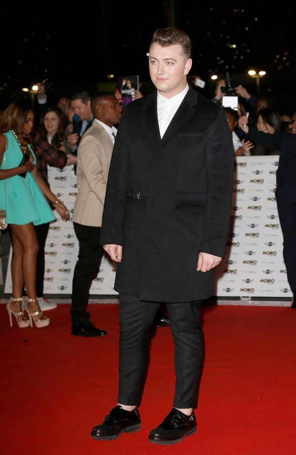 Attending the MOBO Awards on October 22nd, where he took home awards for Best R&B and Soul, Best Song, Best Album and Best Male Act, singer Sam Smith dressed to impress in a look from Pringle of Scotland. The soulful singer paired a cashmere classic coat with an argyle shirt and knit jogging trousers.