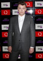 Fostering a growing penchant for designer suits, 'Stay with Me' singer hit the red carpet for the Xperia Access Q Awards on October 22nd in London. Donning a gray windowpane, two-button notch lapel suit from Ermenegildo Zegna, Smith complete his look with a classic white dress shirt.