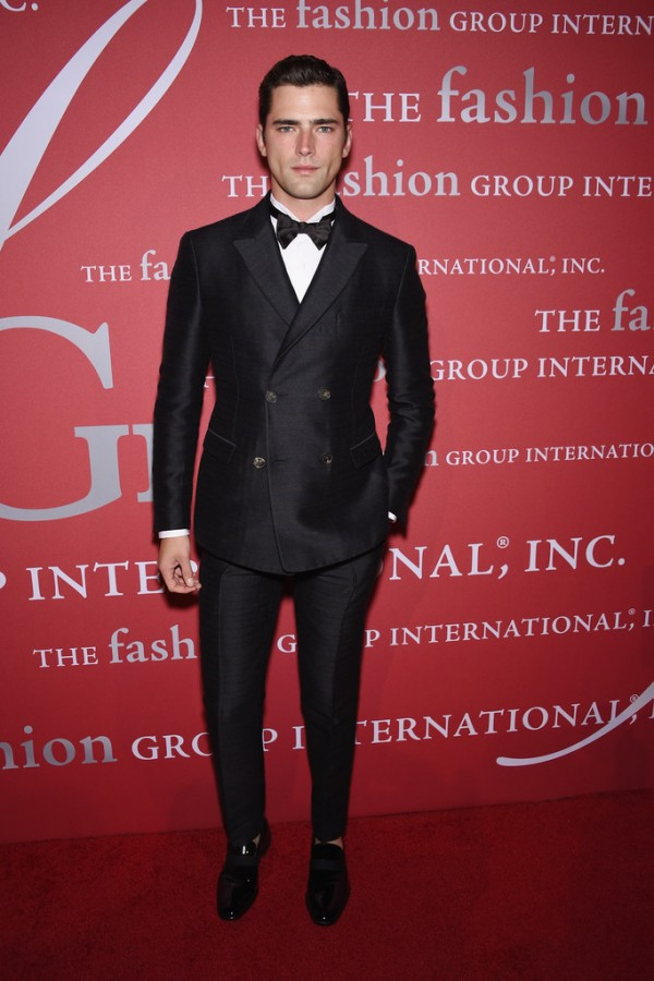 Attending the 31st Annual Fashion Group International Night of Stars gala in New York City last night, top American model Sean O'Pry dressed to impress, sporting a dapper evening look from Italian fashion house Salvatore Ferragamo. A former face of the brand, Sean was dashing in a fall-winter 2014 look that consisted of a double-breasted charcoal and pinstripe evening jacket and trousers, paired with a white tuxedo shirt and patent leather shoes.