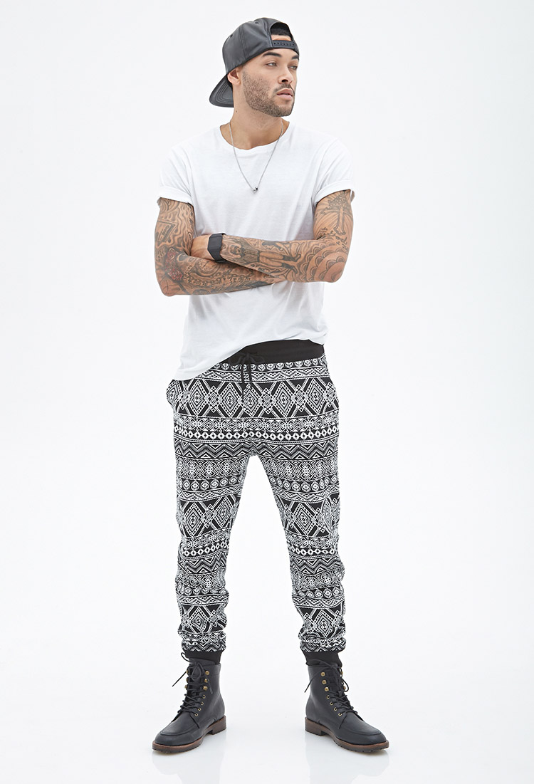 Don wears tribal print sweatpants.