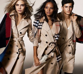 Models Cara Delevingne, Malaika Firth and Tarun Nijjer model Burberry's iconic trench coats in the label's fall-winter 2014 campaign, lensed by fashion photographer Mario Testino.