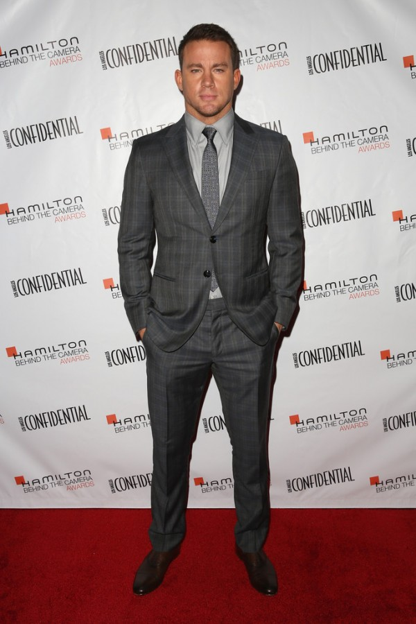 Hot on the heels of filming 'Magic Mike XXL', Channing Tatum touched down in Los Angeles, California on November 9th to attend the 2014 Hamilton Behind the Camera Awards. Sporting a dapper suit from Giorgio Armani, Tatum made a sartorial statement in gray.