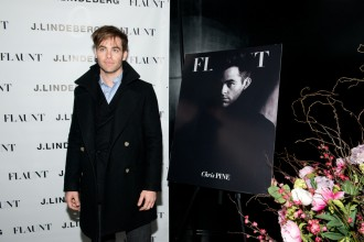 'Into the Woods' star Chris Pine is the latest actor to grace the cover of American magazine Flaunt. Attending a party for the reveal and celebration of his cover on November 22nd in New York City, Pine dressed to impress in a striking double-breasted coat worn over a light blue oxford.