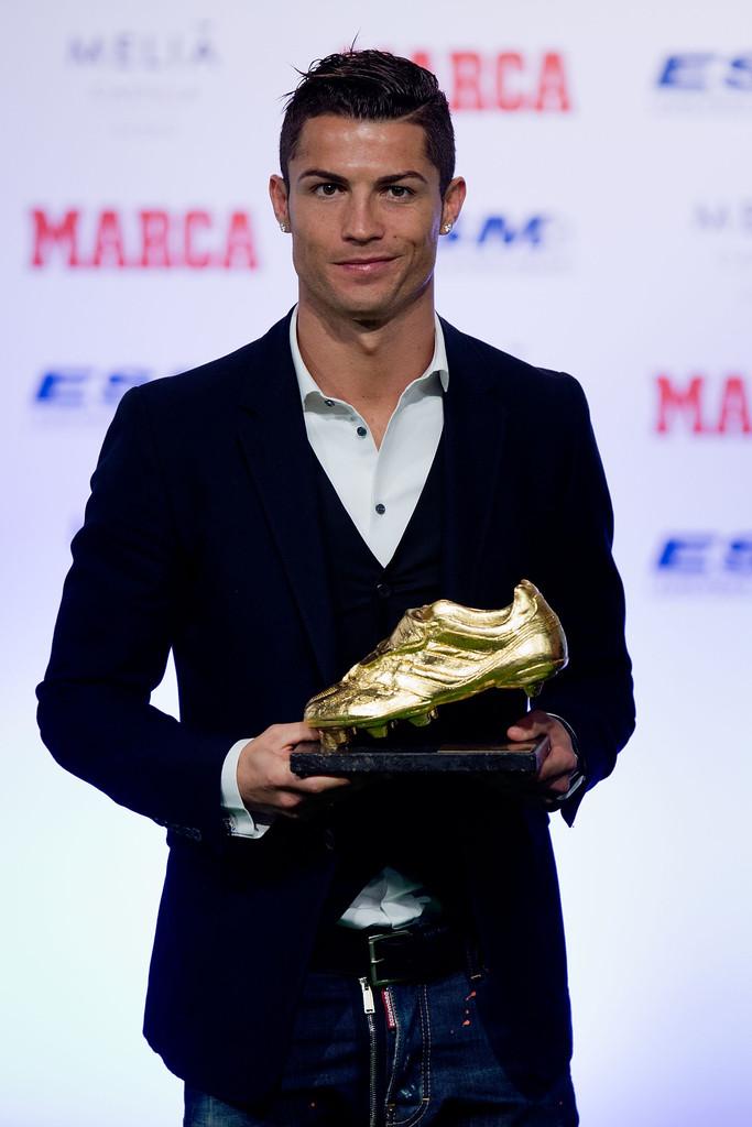Cristiano Ronaldo poses with his third Golden Boot award.