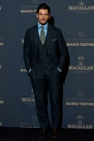 British model David Gandy stepped out with a dapper flair on November 12th to support the launch of The Macallan Masters of Photography: Mario Testino Edition in London. Posing for photos, David wore a three-piece suit with a matching plaid tie and pocket scarf.