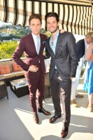 Both wearing Burberry suits, acts Eddie Redmayne and Ben Barnes pose for a photo.