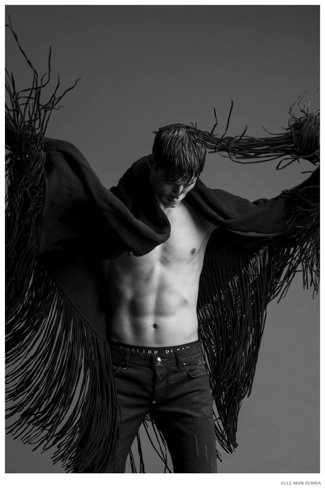 Emilio Flores Embraces Dark Fashions for Elle Man Serbia