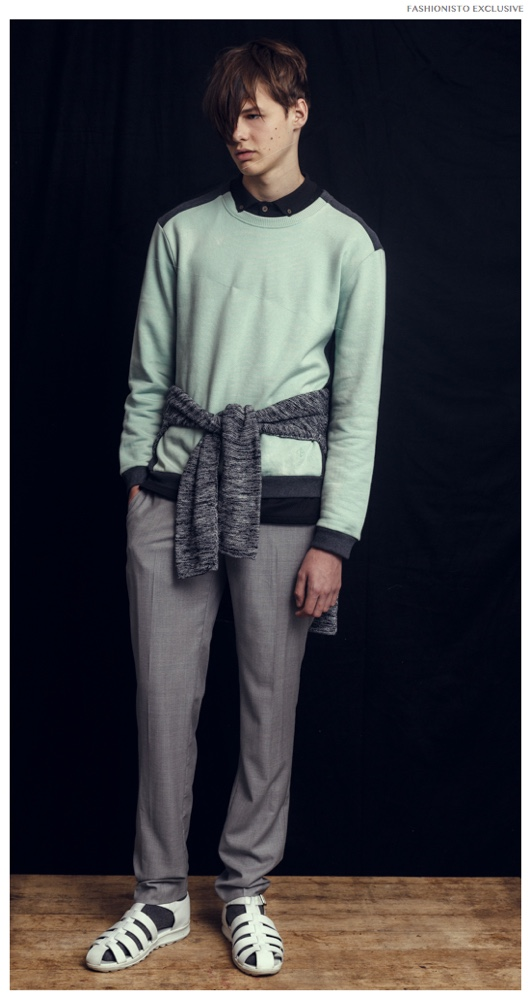 Darwin wears sweater Opening Ceremony, polo shirt Zanerobe, sweater wrapped around waist H&M, trousers Zara and shoes Christopher Kane.