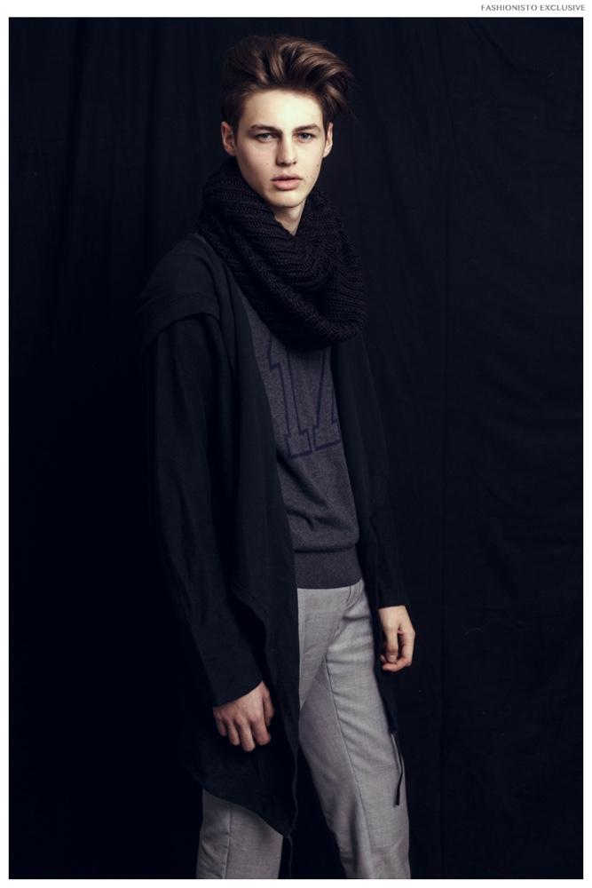 Darwin wears sweater Joe Fresh, scarf H&M, long jacket and trousers Zara.