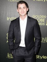 Logan Lerman was all smiles at The Hollywood Foreign Press Association and InStyle's celebration of the Golden Globe award season on November 20th in West Hollywood, California. Going sans tie, Lerman wore a suit from Italian label Ermenegildo Zegna.