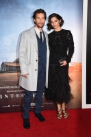 Attending the New York City premiere of 'Interstellar' on November 3rd, Matthew McConaughey once again hit the red carpet in a tailored look from Dolce & Gabbana. Posing alongside his wife Camila Alves, McConaughey dons a three-piece navy suit with a gray overcoat.