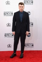 Sam Smith took home the Favorite Pop/Rock Male Artist award at this year's American Music Awards in Los Angeles, California. For the occasion, Smith hit the red carpet in a dashing suit and blue dress shirt from Ermenegildo Zenga Couture.