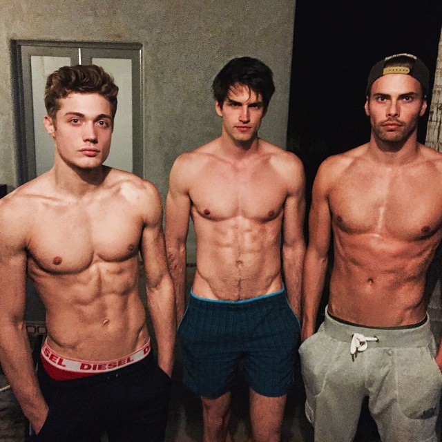 Steven Chevrin, Jakub Zelman and Andreas Eriksen hang out after a gym session.