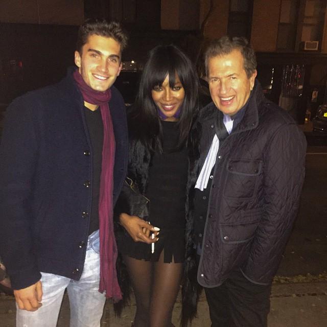 Tomas Guarracino poses for an image with Naomi Campbell and Mario Testino