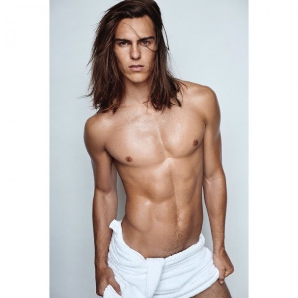 American model Travis Smith follows in the footsteps of Francisco Lachowski as the latest model to appear before the lens of Mario Testino. Stripping down to a white towel, Travis joins a long line of top models to pose for Mario Testino's Towel Series.