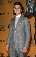 Helping announce the 21st annual Screen Actors Guild Awards Nominations in Los Angeles, California on December 10th, actor Ansel Elgort dressed to impress in a spring-summer 2015 look from Italian fashion label Brioni. Elgort sported an overprinted wool and mohair Prince of Wales suit, paired with a crewneck sweater and white cotton poplin formal shirt.