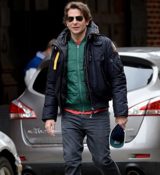 Bradley Cooper made a mad dash for the subway this past weekend as he rushed to a Sunday show of 'The Elephant Man'. With temperatures in New York City dropping, Cooper kept warm in a Parajumpers GOBI bomber jacket. For extra warmth, the 39 year-old actor layered with a bright green down jacket.