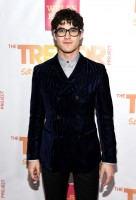 Attending TrevorLIVE La for The Trevor Project on December 7th, 'Glee' actor Darren Criss was smart in a pair of black framed glasses, worn with a fall-winter 2014 double-breasted velvet suit from Italian fashion label Emporio Armani.