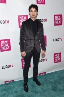 Attending Logo TV's 2014 NewNowNext Awards on December 2nd in Miami Beach, Florida, 'Glee' actor Darren Criss brought slim-cut glamour to the arrival photos. Stopping to pose for photos, Criss wore Topman's gray printed skinny fit velvet jacket with navy jacquard skinny dress pants.