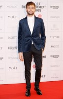 Hitting the red carpet for The Moet British Independent Film Awards on December 7th in London, actor Douglas Booth wore a look from Topman. Booth paired a navy velvet check skinny fit blazer with a premium long sleeve white pin collar smart folded shirt, black ultra skinny dress pants and Brompton monk black leather oxford shoes.